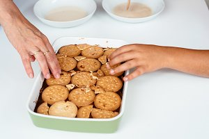 Family preparing homemade chocolate