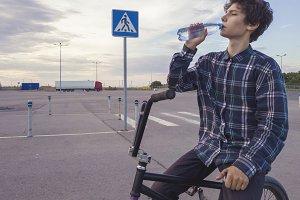 portrait of young teenage boy drinki