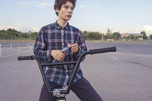 young urban street rider drinking wa