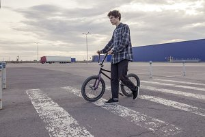 portrait of young man with bmx bicyc