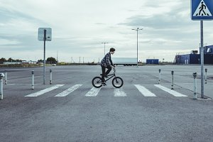 young man riding a bmx bicycle bike