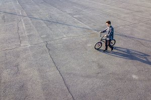 copy space young boy with bike on as