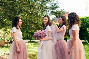 Bridesmaids are preparing the bride