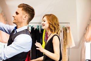 Man is choosing dress