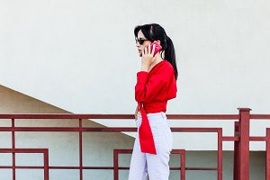 Portrait of woman talking by phone