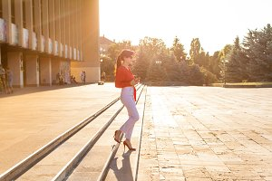 Young business woman walking in the