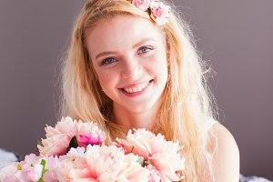 Young pretty woman holds flowers