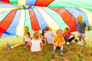 Laughing kids hide in multicolor
