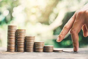 Female hand walking on money