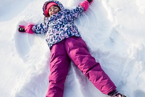 Girl makes snow angel
