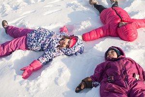 Three angels on the snow