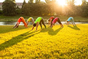 Active women practicing yoga outside