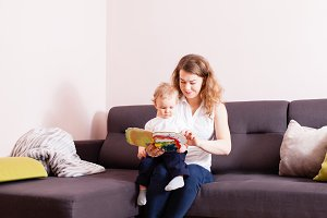 Mother and her son reading book