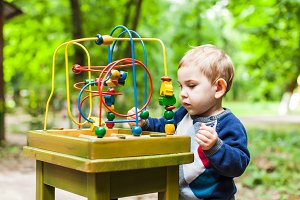 Boy plays with a multicolored