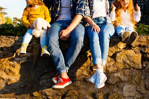 The family in jeans and sneakers