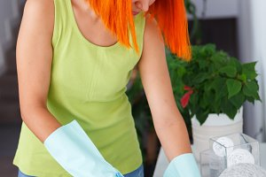 Red hair housewife cleaning her home