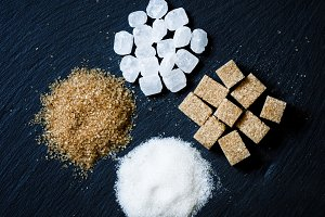 Assortment of sugar: white sand, can