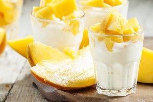 Homemade yogurt with fresh mango sli