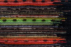 Homespun carpet, colored stripes