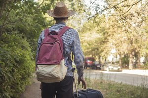 young traveling man with backpack an