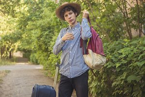 young teenager boy in summer hat and