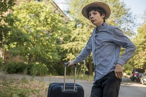 teenage boy in summer hat travelling