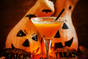 Orange Halloween cocktail and holida