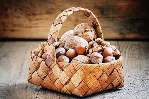 Hazelnuts and walnuts in a wicker ba