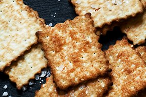 Crispy golden crackers with salt on