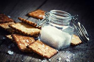 Salty cracker and sea salt in a pot