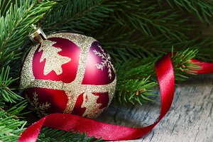 Red and gold Christmas ball, fir bra