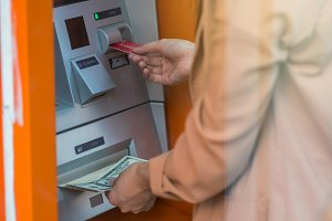 woman withdrawing the cash via ATM,