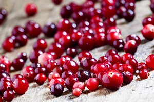 Fresh cranberry on old wooden table,