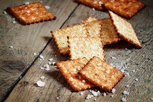 Salty cracker and sea salt on a dark