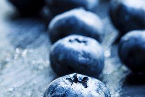 Fresh ripe blueberries on a dark bac