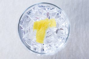 lemon peels on a gin tonic glass