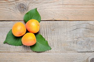 Apricots on wooden table top view