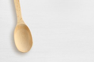 Wooden spoon on white table