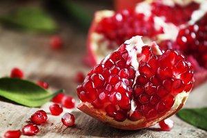 Ripe red pomegranate on an old woode