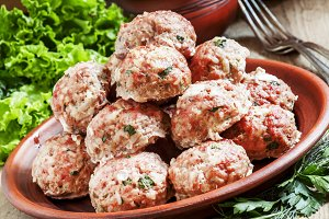 Delicious meat cutlets with herbs on