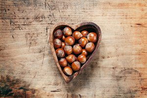 Fresh hazelnuts in a wooden bowl in