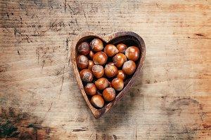 Fresh hazelnuts in a wooden bowl in