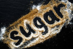 "Text ""sugar"" of white and brown cane"