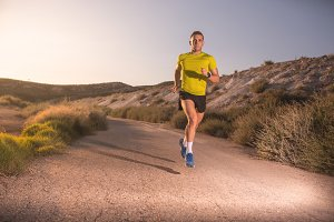 Young man running with greenish yell
