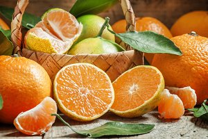 Cut ripe juicy orange tangerines, se