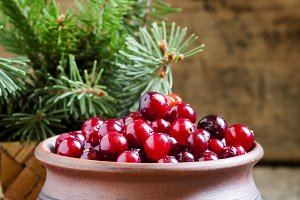Fresh cranberries in a clay pot in a