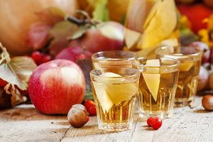 Apple cider in the autumn background