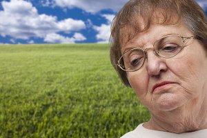 Melancholy Senior Woman with Grass F