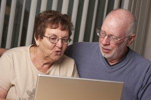 Smiling Senior Adult Couple Having F
