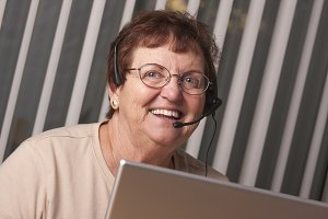 Smiling Senior Adult Woman with Tele